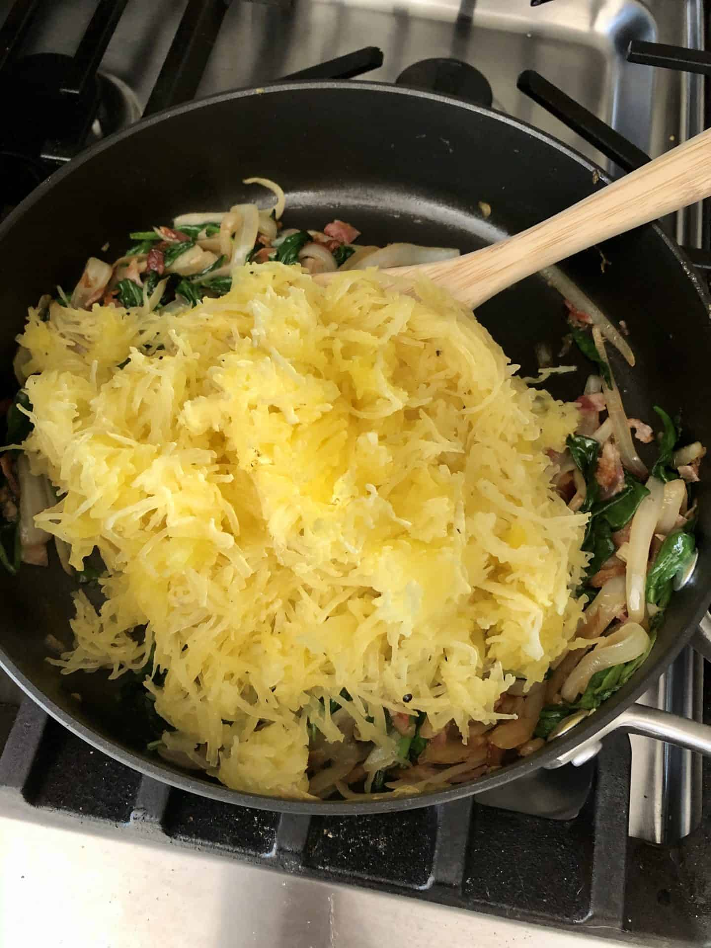Spaghetti Squash added to pan with spinach and onions
