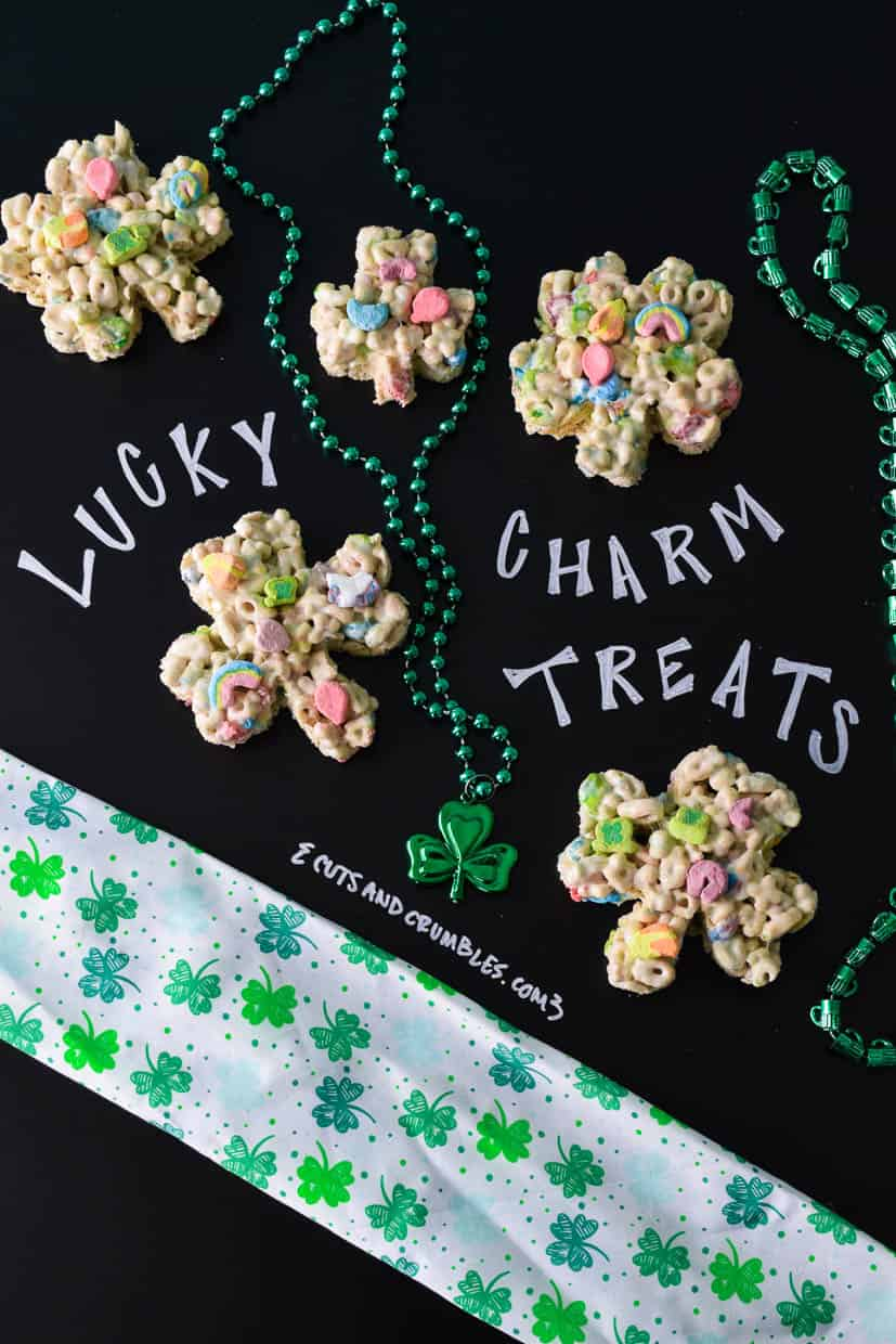 Lucky Charm Treats with St. Patrick's day beads and title written on chalkboard