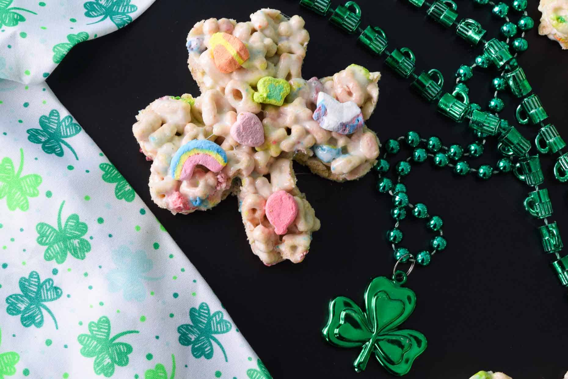 Lucky Charm Treat shaped like a cover with St. Patrick's day scarf and necklace close up view