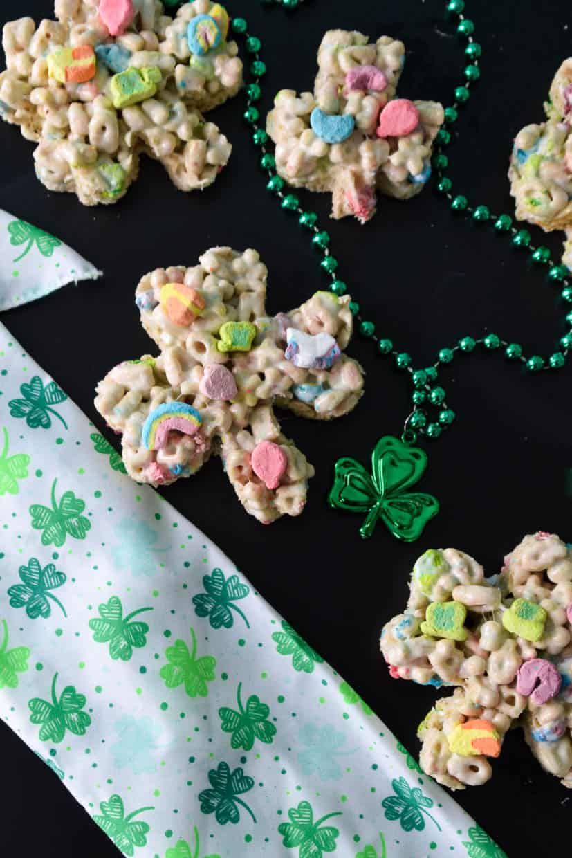 Multiple Lucky Charm Treats with St. Patrick's day scarf and beads overhead shot