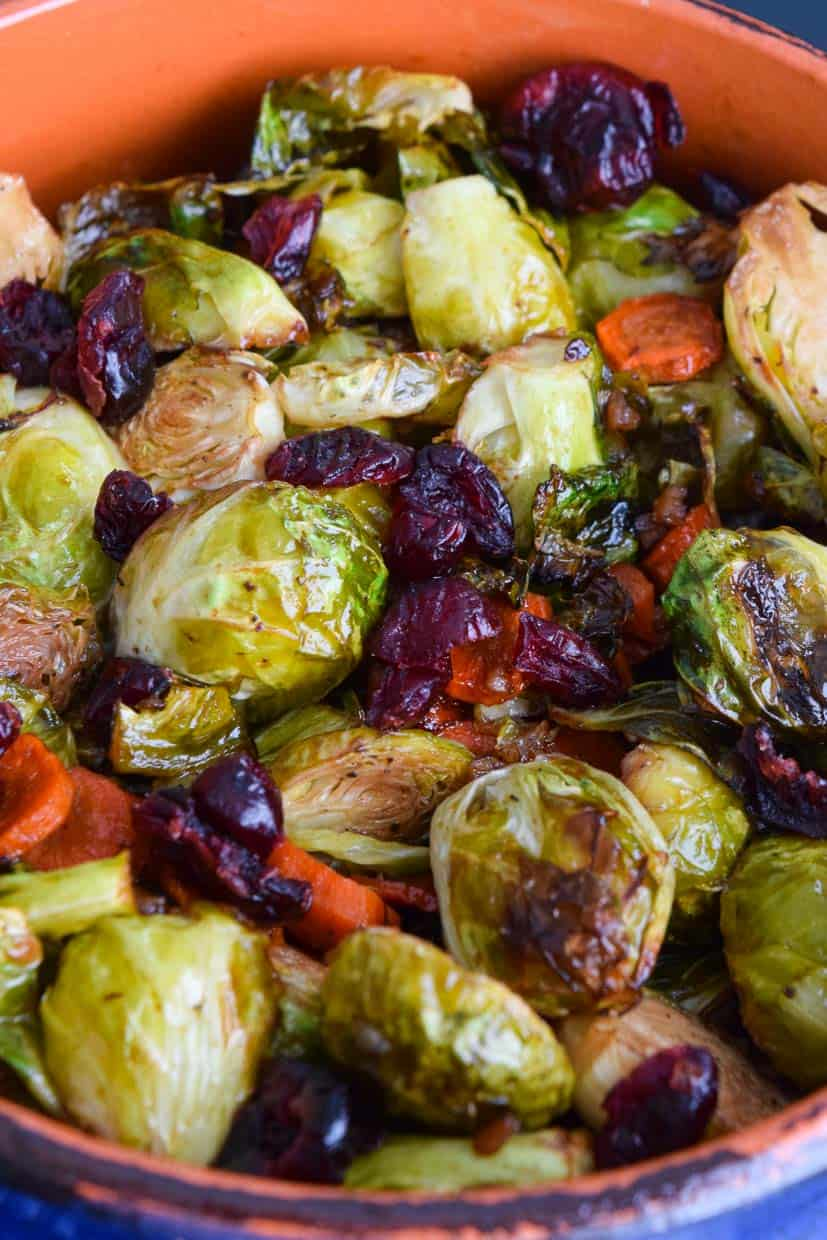 up close shot of roasted Brussels sprouts in orange and blue bowl