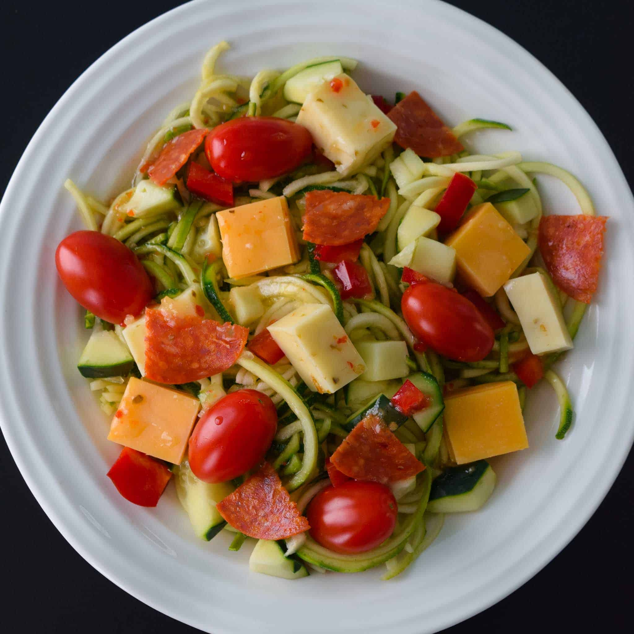 Zoodle Pasta Salad in white bowl overhead shot