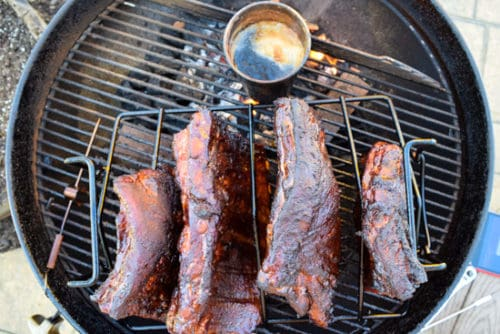ribs on rib rack on weber grill overhead shot