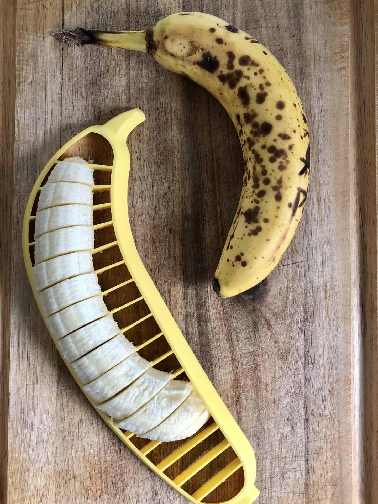 Bananas being sliced with a banana slicer