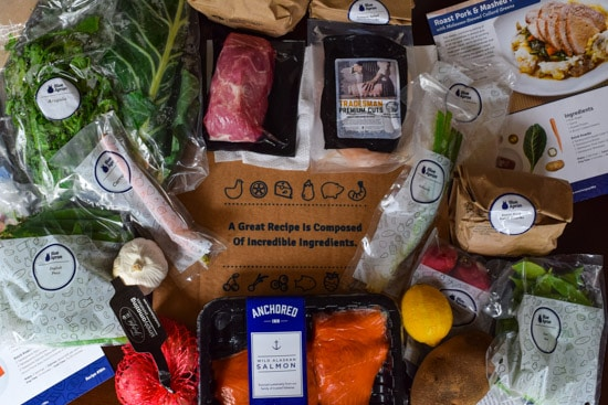 blue apron ingredients on top of box overhead shot