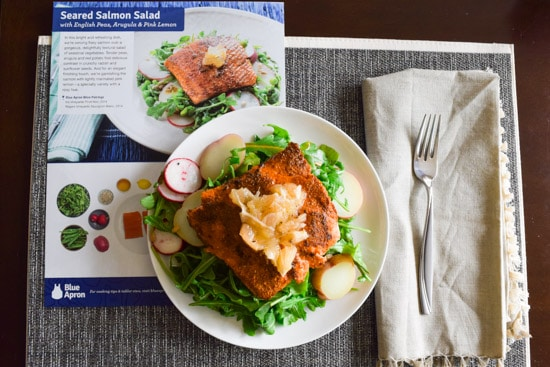 blue apron seared salmon salad on plate beside recipe card