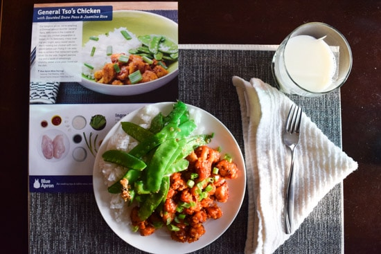 Blue Apron General Tso's Chicken on plate beside recipe card