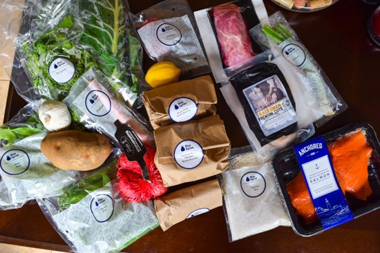 Variety of labeled ingredients for blue apron meals
