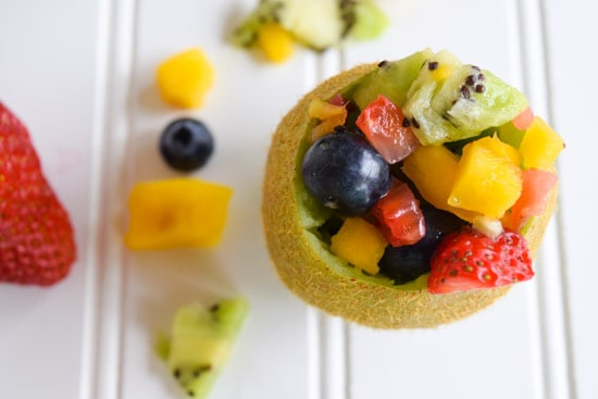 tropical fruit salad in kiwi cups