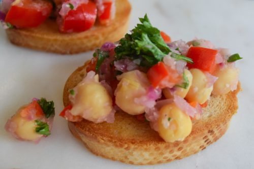 Chickpea 'Bruschetta' on crostini close up view