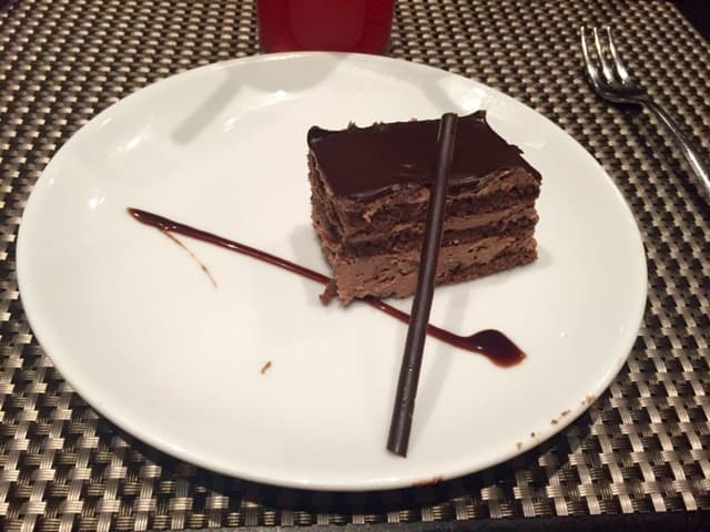Layered chocolate cake on white plate
