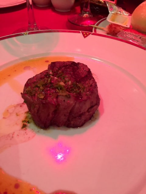 Filet on plate with red lighting