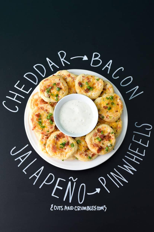 Cheddar Bacon Jalapeño Pinwheels with title written on chalkboard