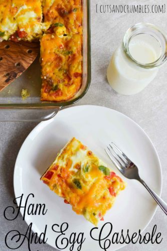 ham and egg casserole on white plate with title overhead shot