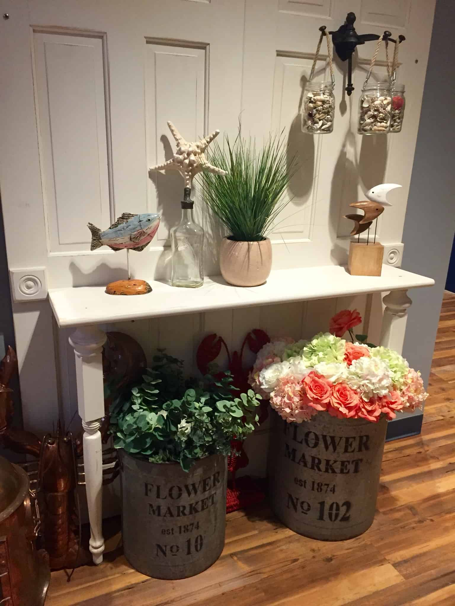 The Claw House Restaurant entryway table with various nautical decor