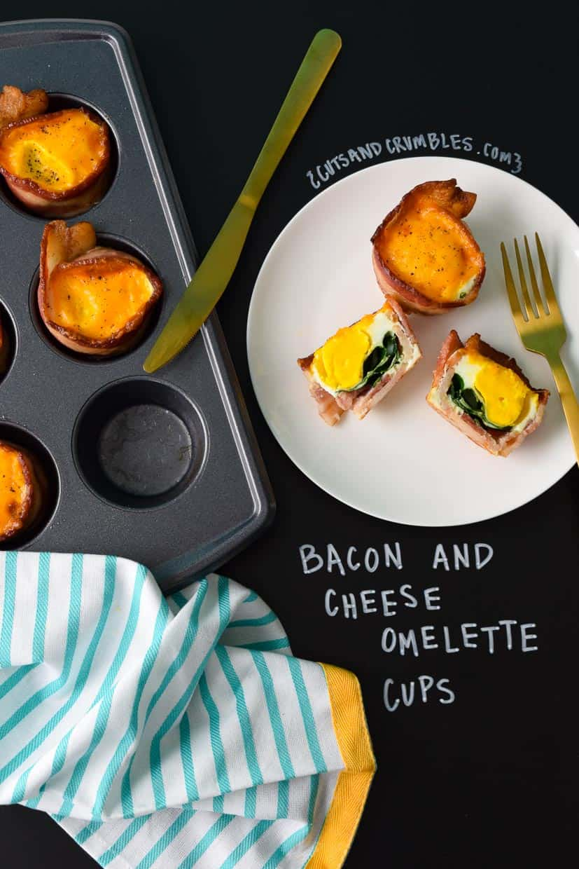 Bacon and cheese omelette cups on white plate with title written on black chalkboard