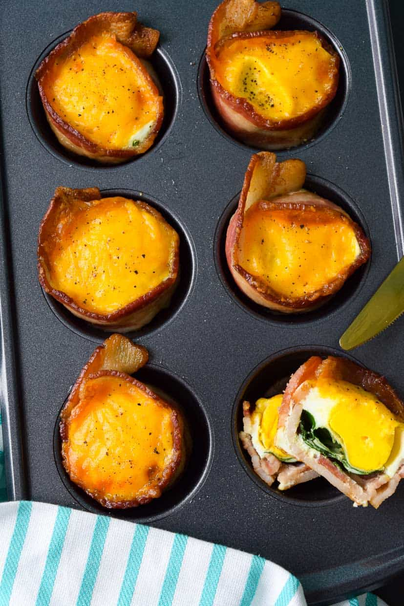 Close up overhead shot of cooked bacon and omelette cups