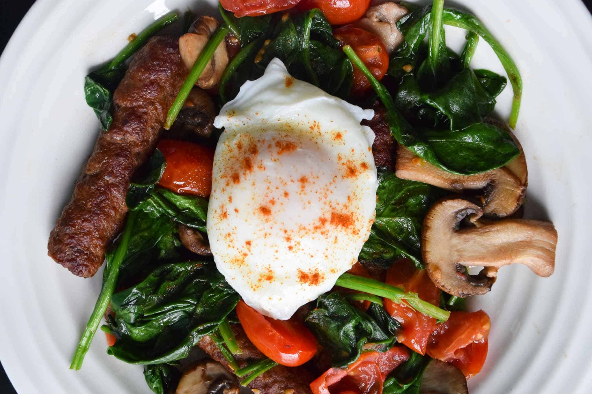 Poached Eggs Over Chicken Sausage and Veggies overhead shot