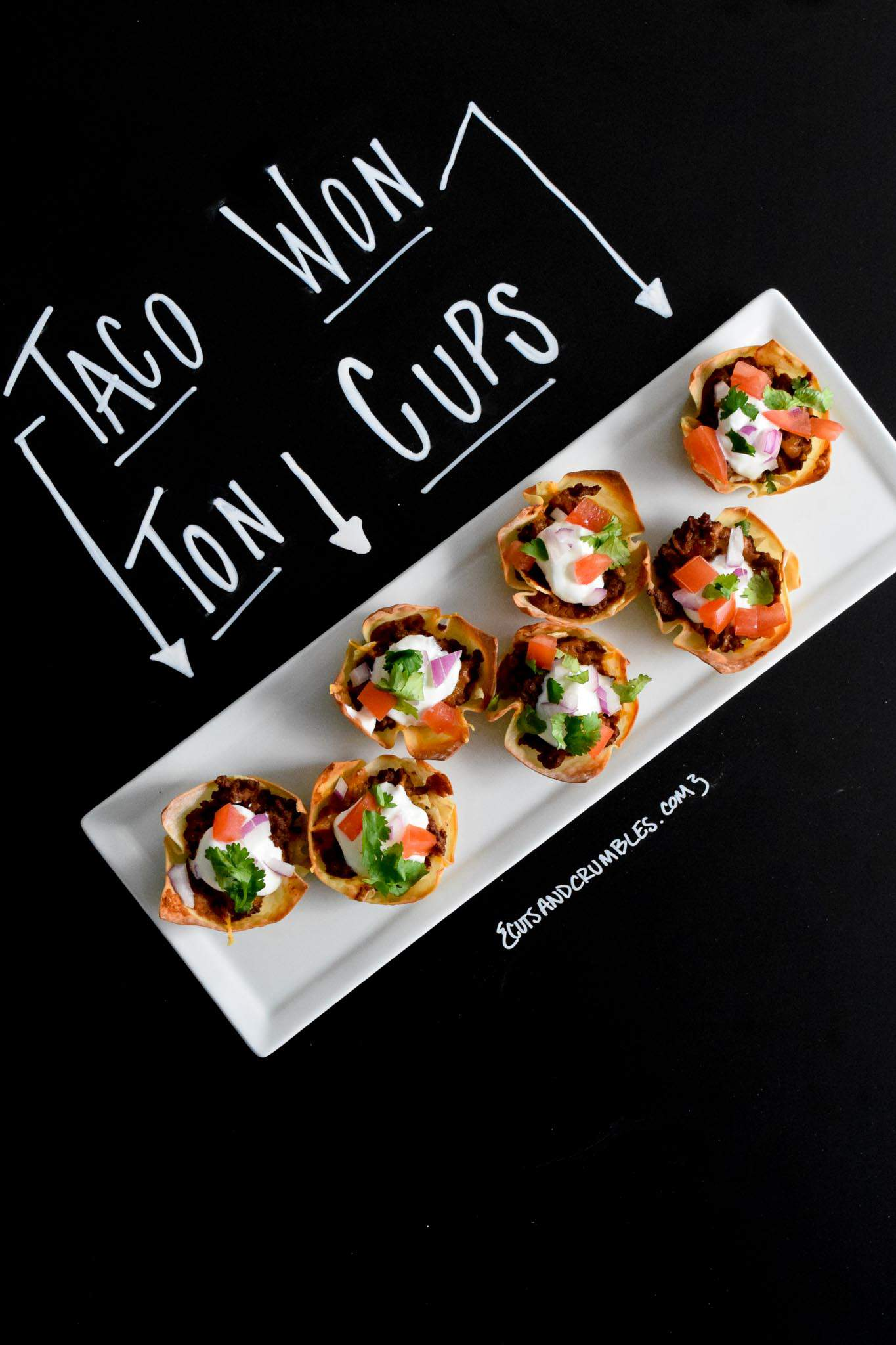 taco won ton cups with title written on chalkboard