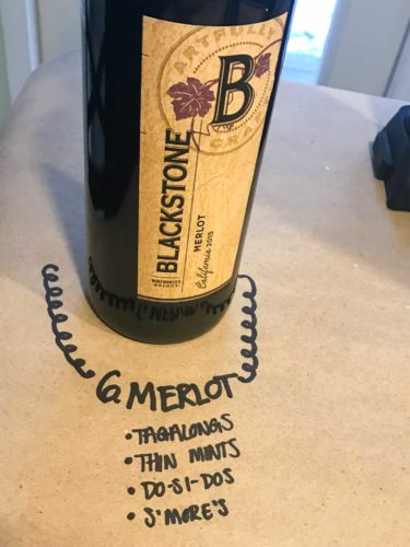 bottle of merlot on brown paper with cookie pairings written underneath