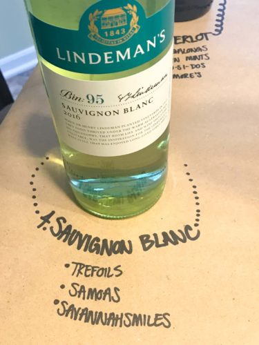 bottle of sauvignon blanc on brown paper with cookie pairings written underneath