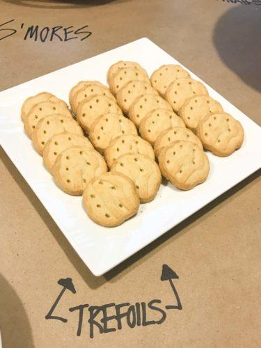 Girl Scout cookie trefoils on white platter