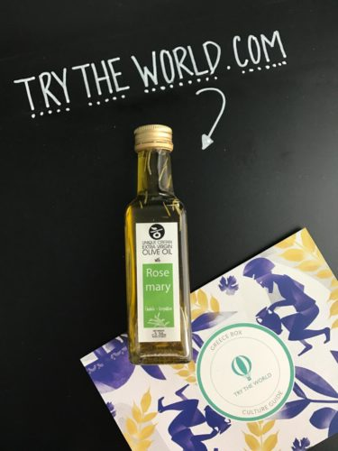 Small bottle of rosemary infused olive oil with try the world card beside it