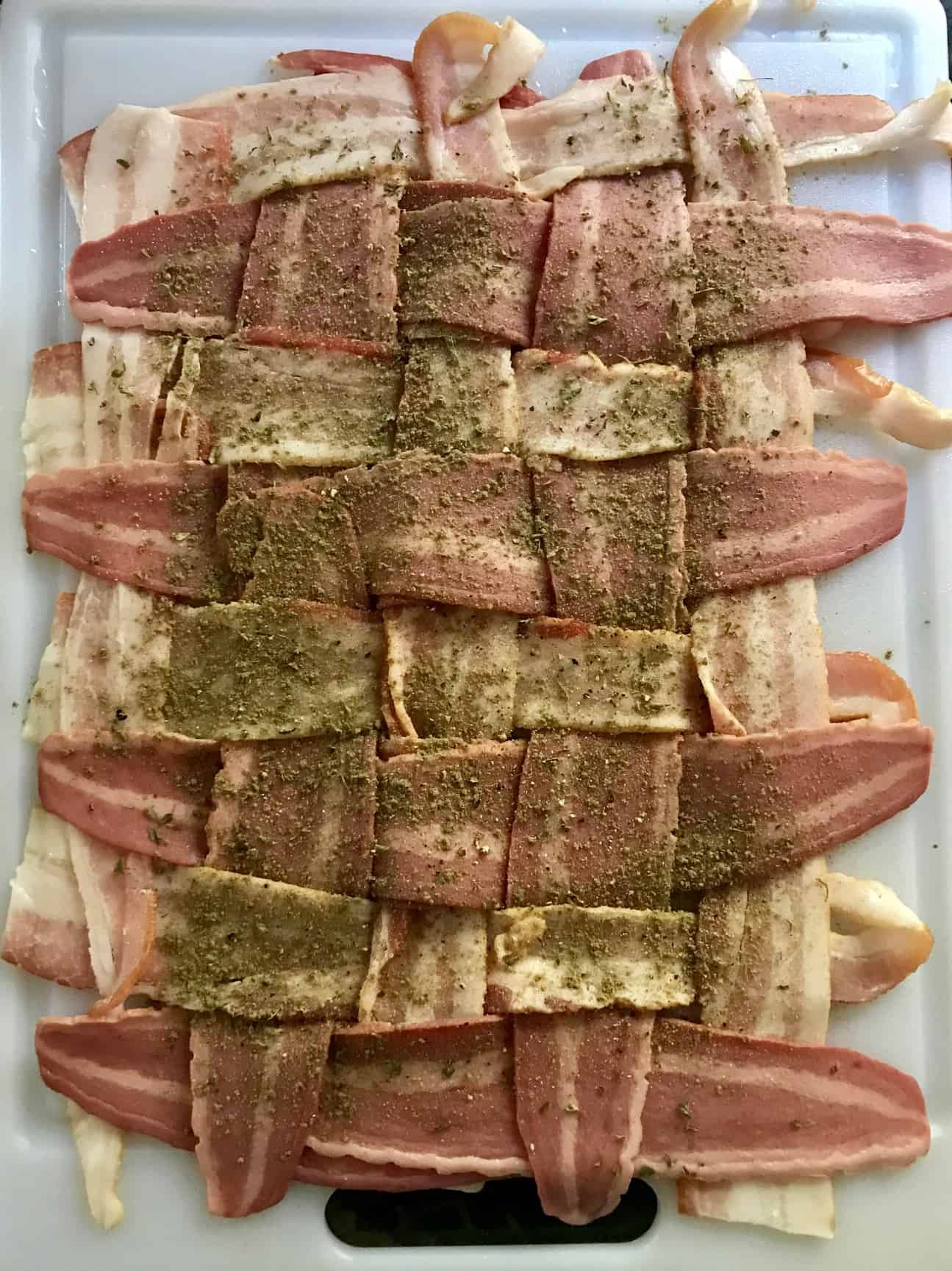 Bacon weave covered with seasoning overhead shot