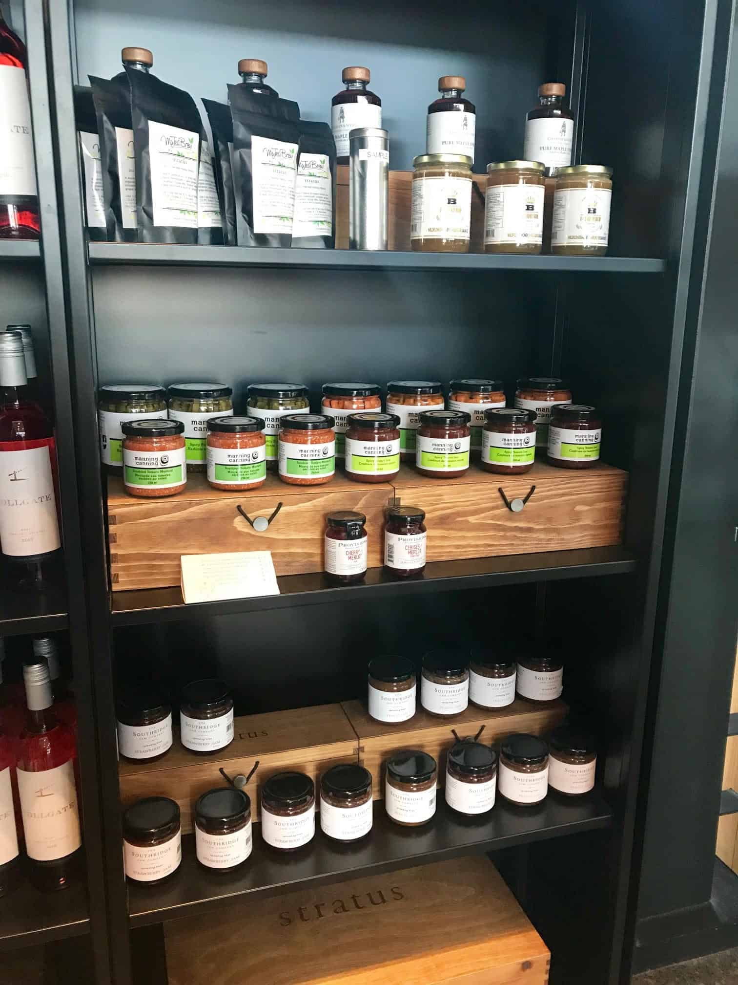 Shelf of products for sale by Manning canning