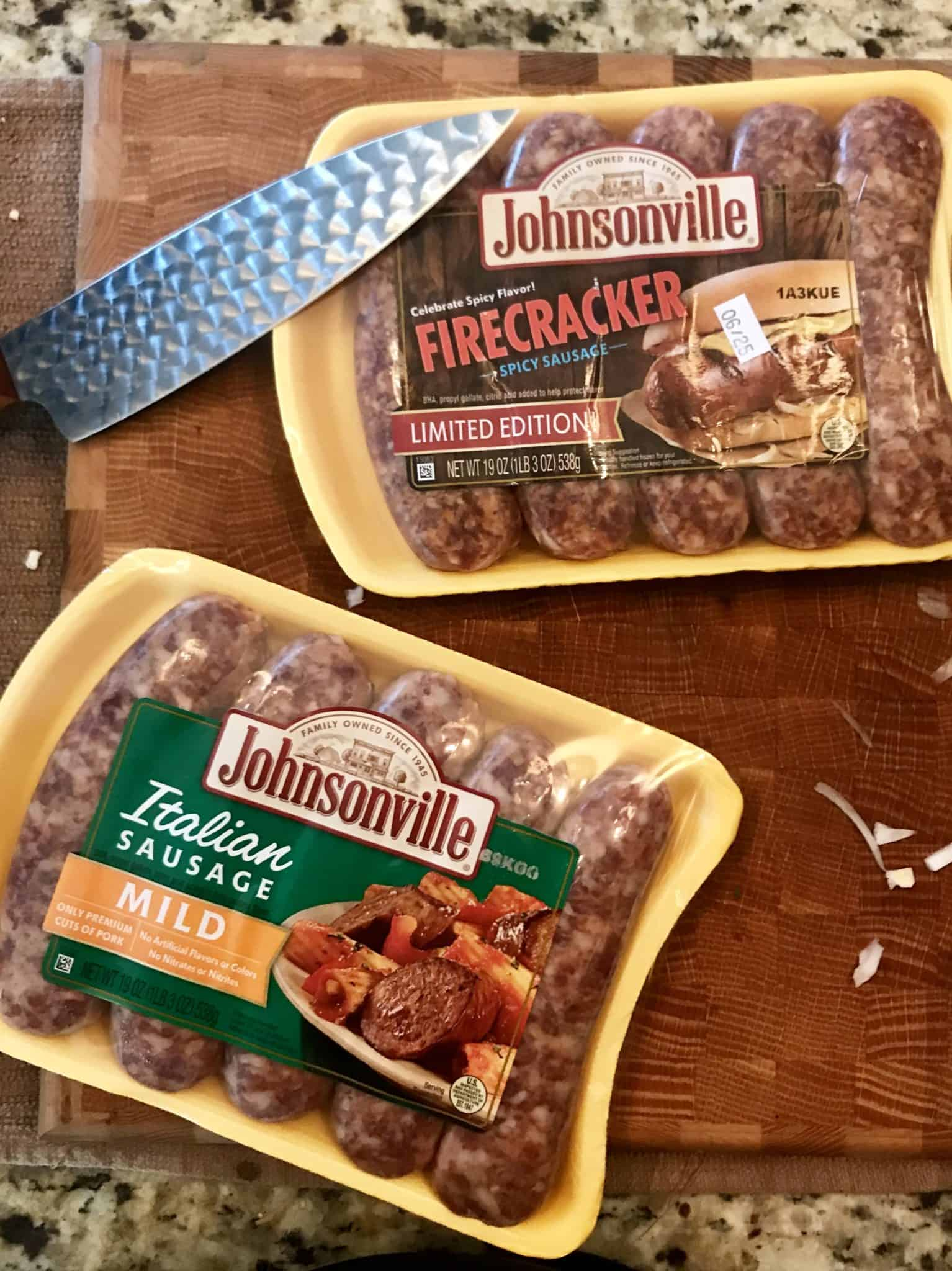 Johnsonville firecracker and mild Italian sausage packs on wooden cutting board overhead shot
