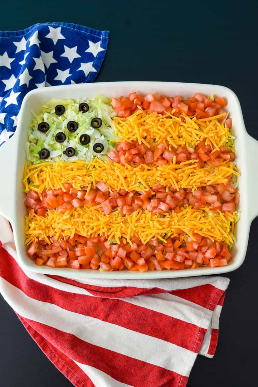 9x13 pan with all dip ingredients designed to look like American flag overhead shot