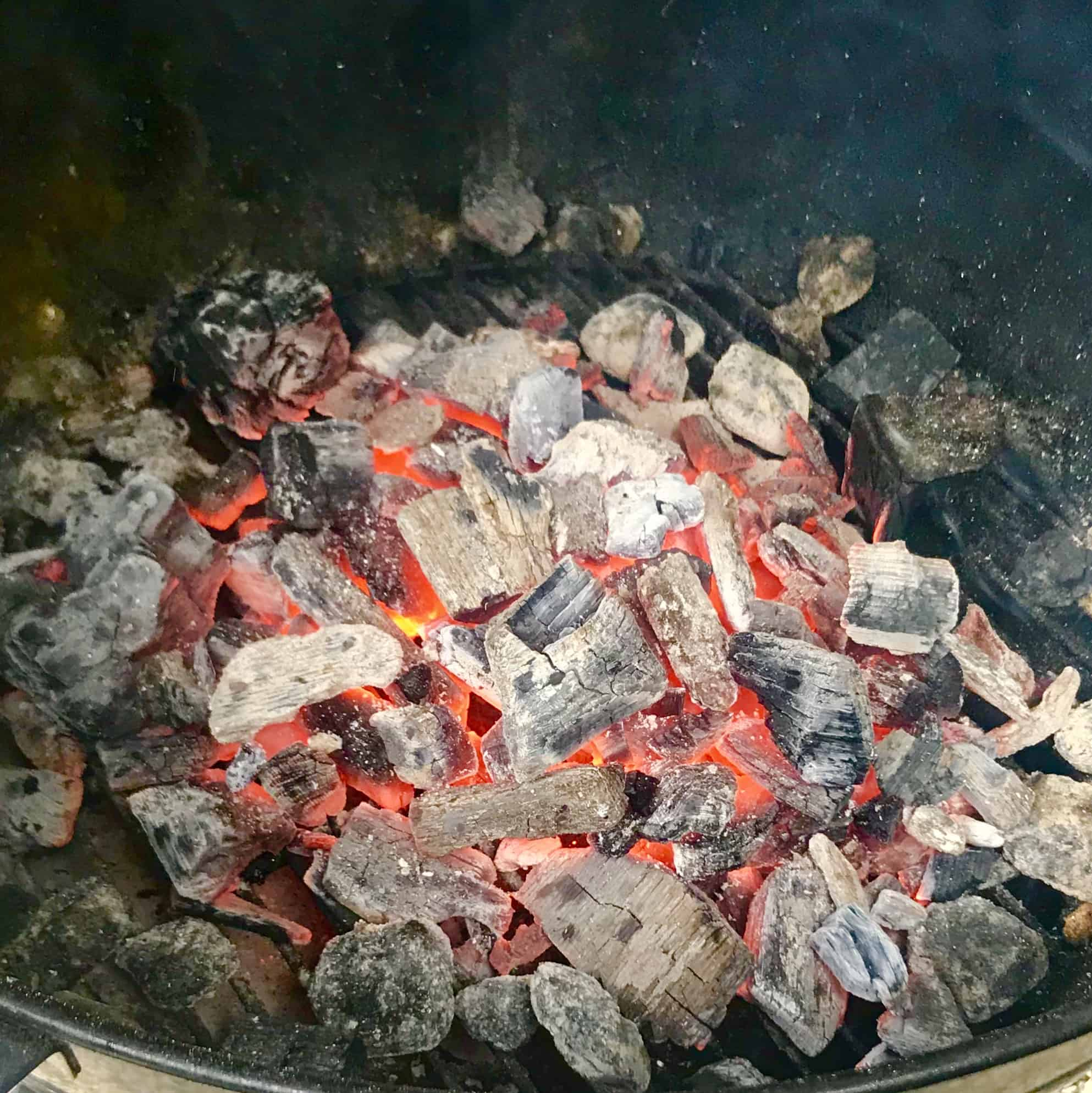 Hot coals on grill close up view