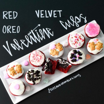 Red Velvet Oreo Valentine Cups on white platter with chalkboard writing