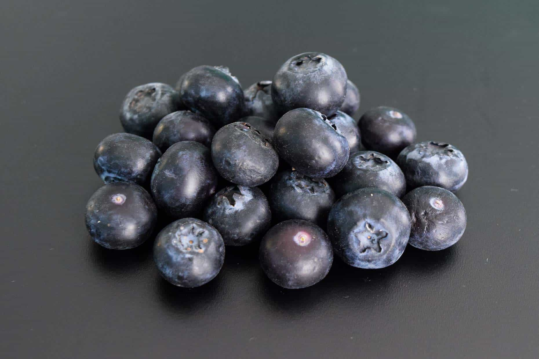 Blueberries on black background