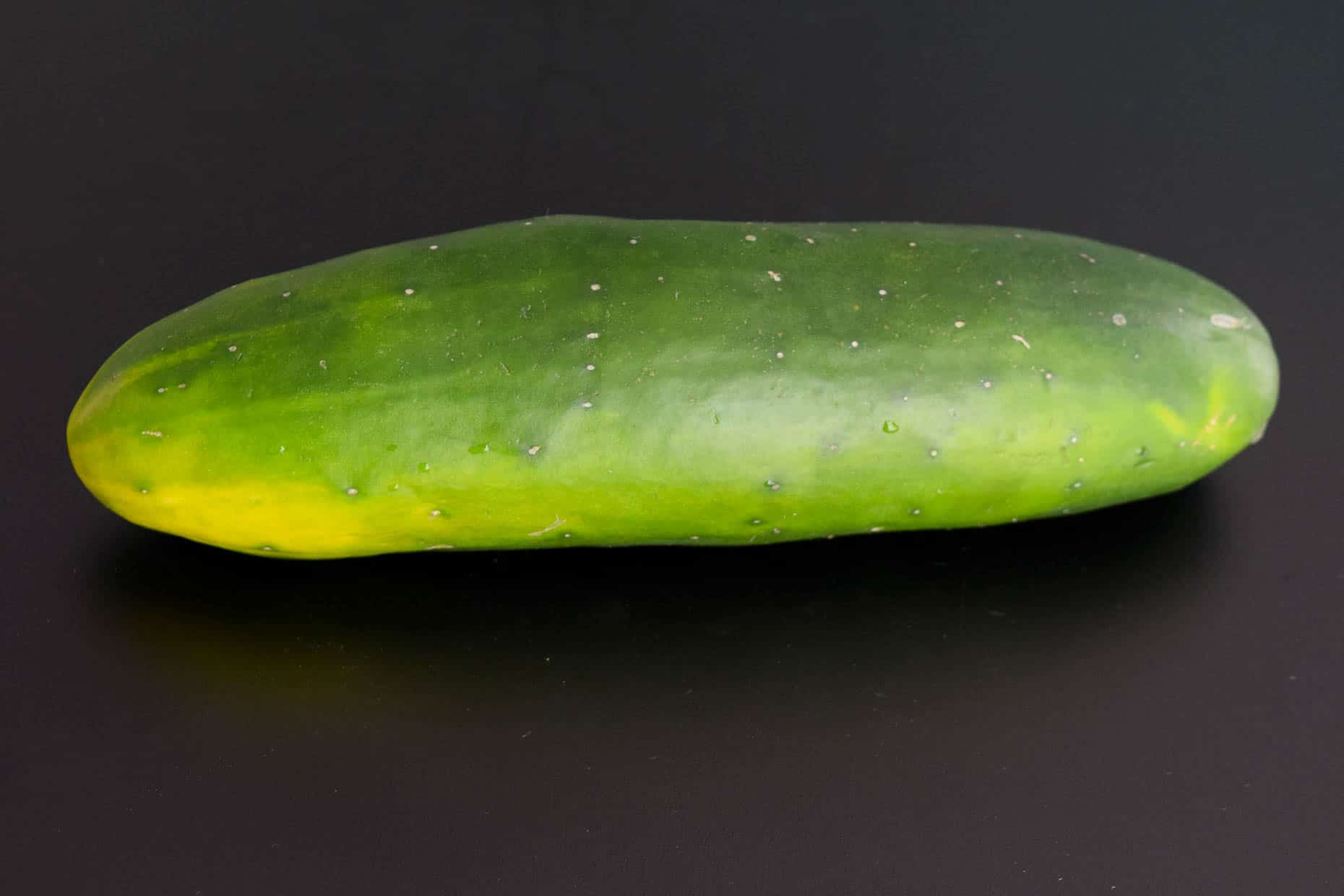 Cucumber on black background