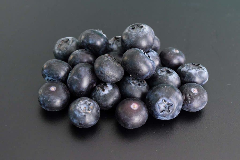 blueberries on black background