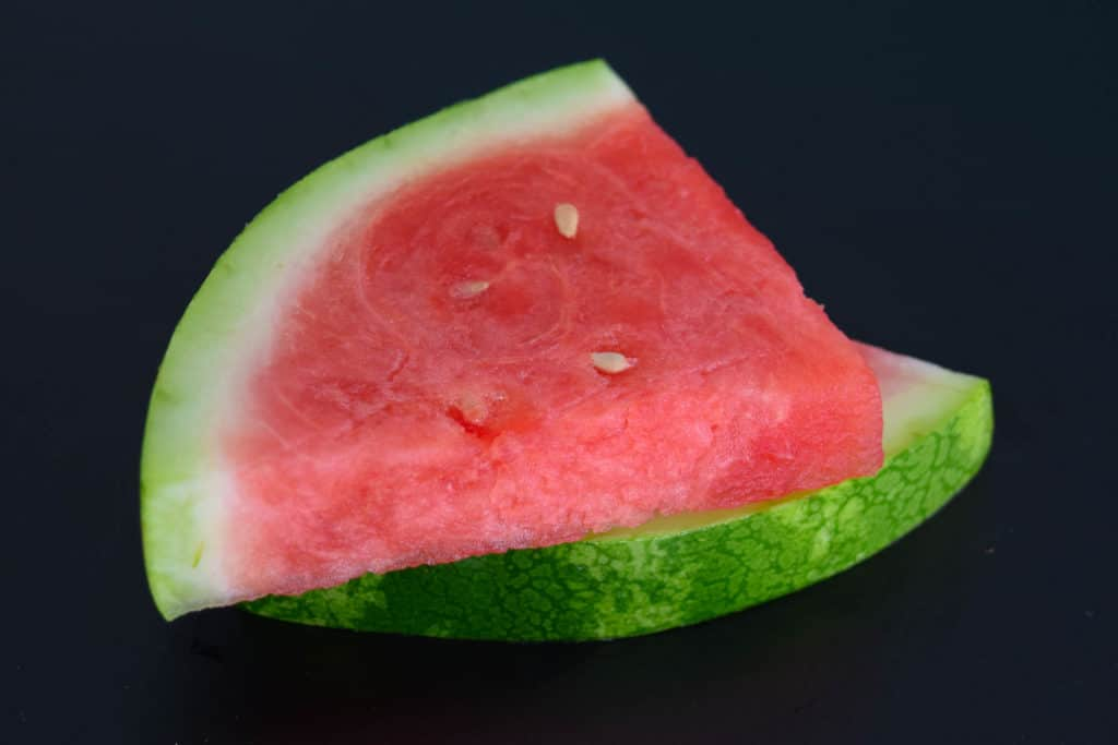 watermelon slices on black background