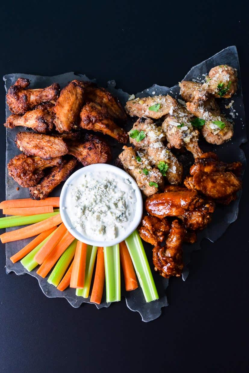 Air Fryer Game Day Wings served on black Ohio shaped platter with blue cheese and veggies overhead shot