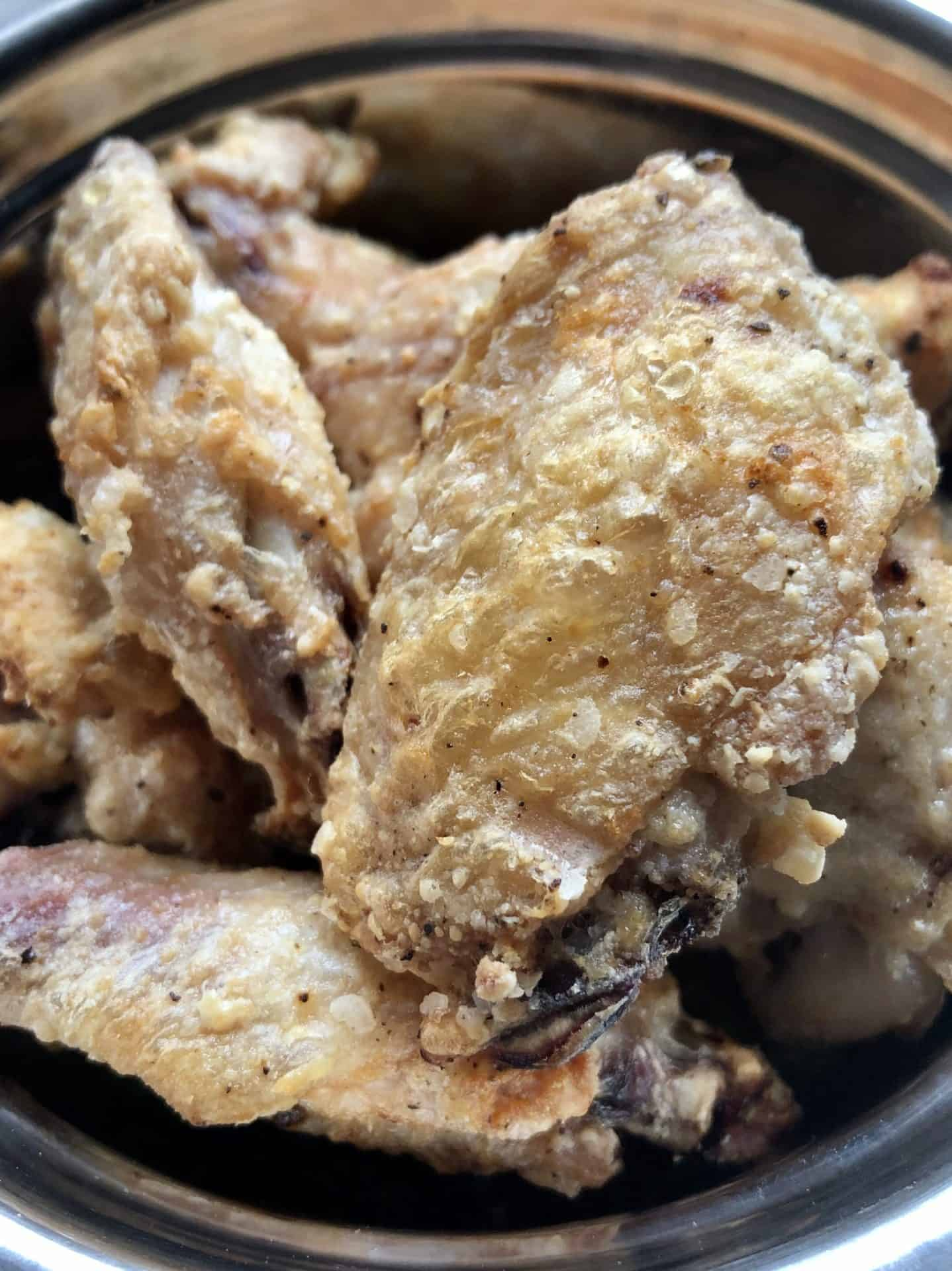 Close up view of air fried chicken wings before sauce