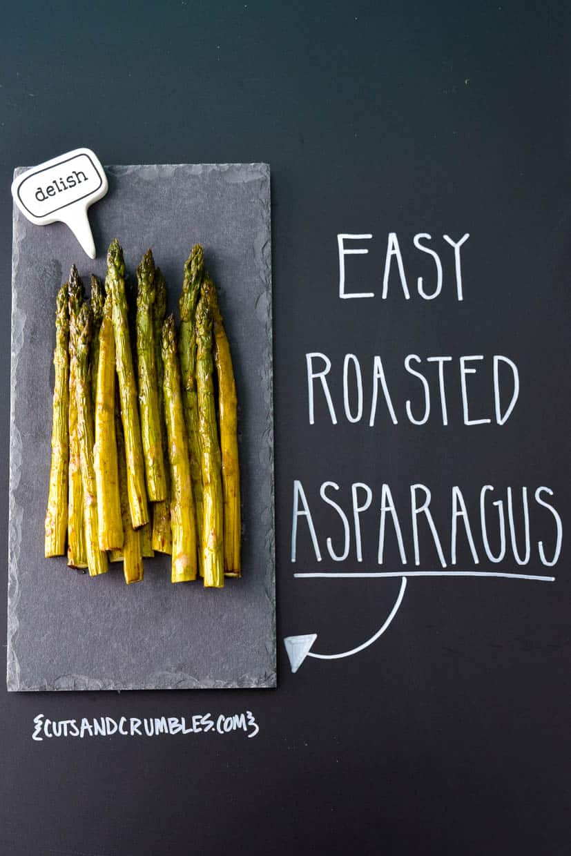 Easy Roasted Asparagus on slate platter with title written on chalkboard