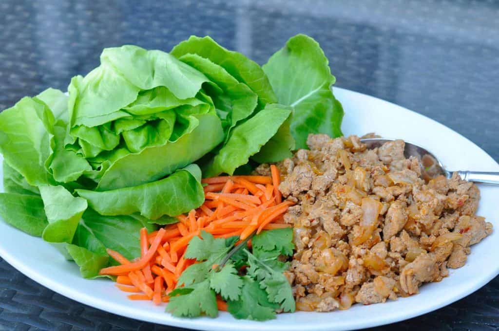 Lettuce wrap ingredients on white plate