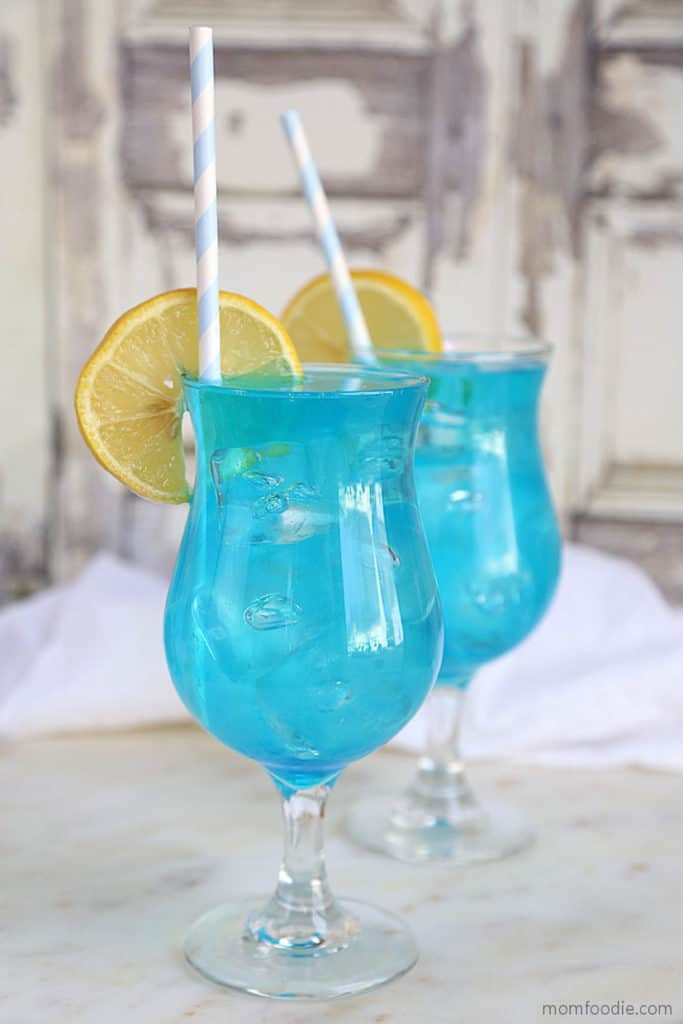 bright blue drinks with lemon slices