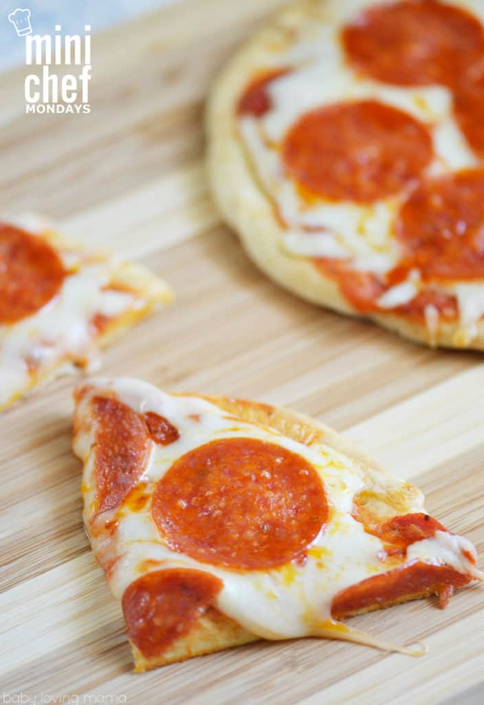 sliced flatbread pizza on cutting board