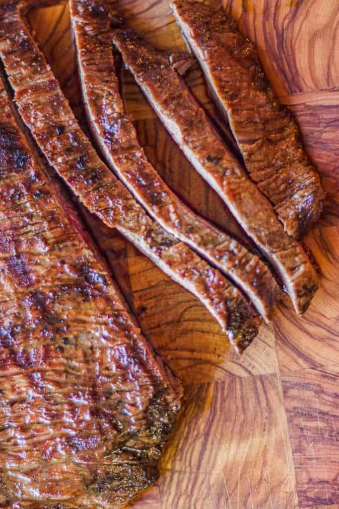 carne asada sliced on cutting board