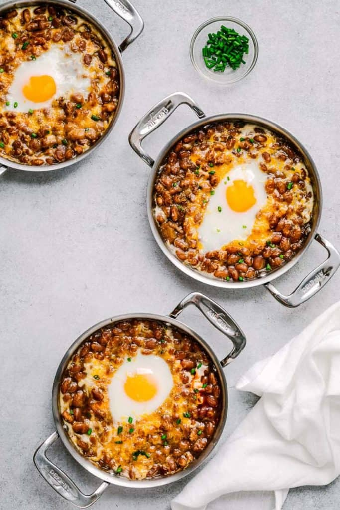 beans with overeasy eggs in individual pots