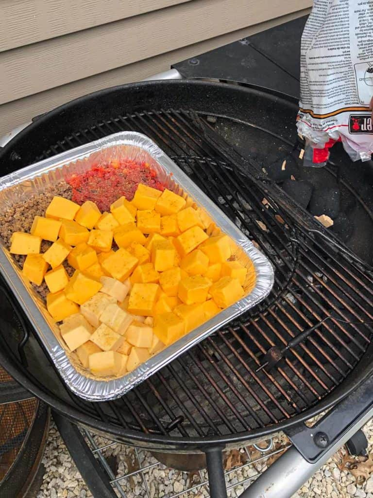 Smoked queso dip on weber grill ready to be smoked