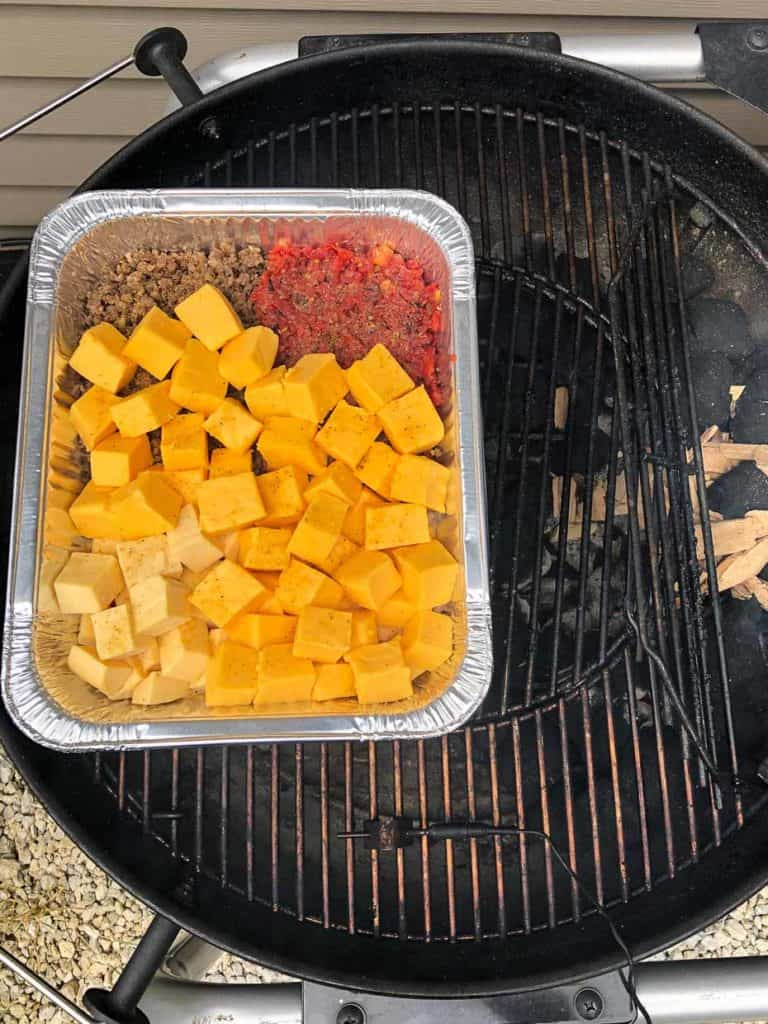 smoked queso dip pan on weber grill overhead shot
