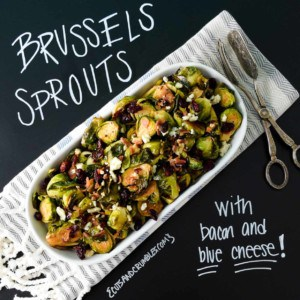 Brussels sprouts with bacon and blue cheese in white platter with title written on black background