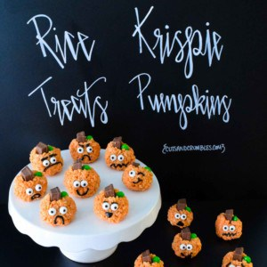 Pumpkin shaped Rice Krispie treats pumpkins with various faces with title written on black background