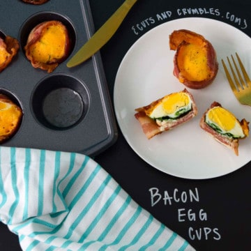 Bacon Egg Cups served on white plate with title written on black on chalkboard overhead shot